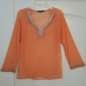 Wear as a blouse or cover up